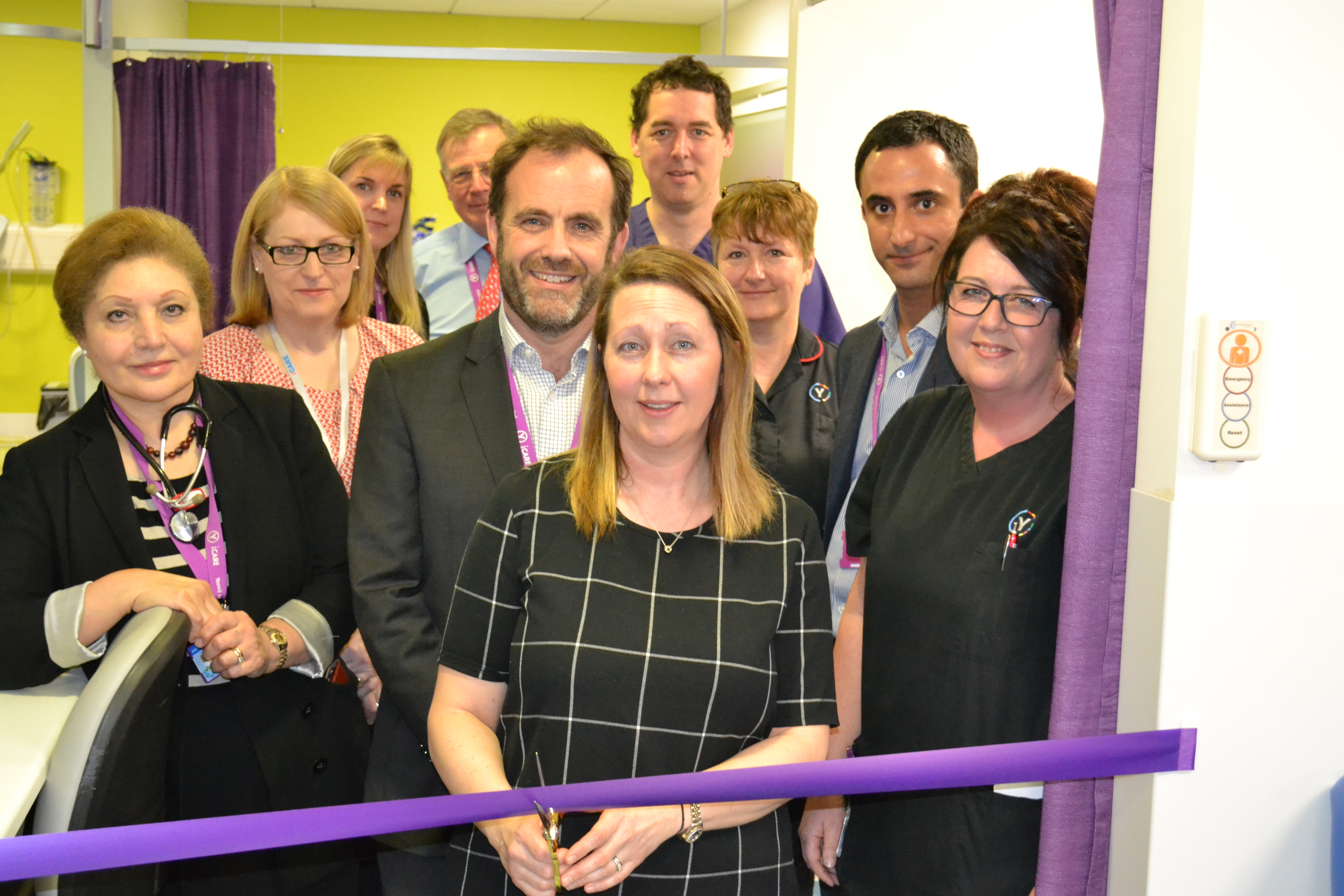 Julie Reeve (front right) and Paul Mears (centre) join Lisa Callow (front), wife of Wayne Callow, in opening the Ambulatory Emergency Care (AEC) Unit at Yeovil Hospital.